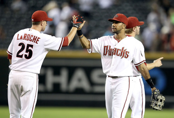 PHOENIX - SEPTEMBER 21:  Chris Young #24 of the Arizona Diamondbacks celebrates with teammate Adam LaRoche #25 after defeating the Colorado Rockies during the Major League Baseball game at Chase Field on September 21, 2010 in Phoenix, Arizona.  (Photo by