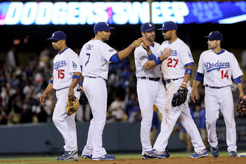 LOS ANGELES, CA - JUNE 09:  (L-R) Rafael Furcal #15, James Loney #7, Casey Blake #23, Matt Kemp #27 and Jamey Carroll #14 of the Los Angeles Dodgers celebrate their teams victory and three-game sweep of the St. Louis Cardinals at Dodger Stadium on June 9,