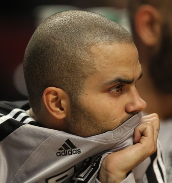 CHICAGO, IL - FEBRUARY 17: Tony Parker #9 of the San Antonio Spurs sits on the bench watching his teammates take on the Chicago Bulls at the United Center on February 17, 2011 in Chicago, Illinois. The Bulls defeated the Spurs 109-99. NOTE TO USER: User e