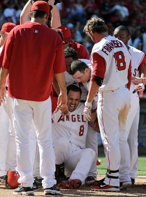 ANAHEIM, CA - MAY 29:  Kendry Morales #8 of the Los Angeles Angels reacts to his injury on his way to home plate after his grand slam homerun to win the game 5-1 over the Seattle Mariners during the bottom of the ninth inning at Angel Stadium on May 29, 2