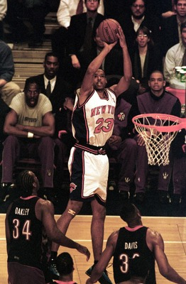 26 Apr 2000:  Marcus Camby #23 of the New York Knicks puts up a shot over Charles Oakley #34 and Antonio Davis #33 of the Toronto Raptors during Game 2 of the first round of the Eastern Conference quarter-finals at Madison Square Garden in New York. Manda