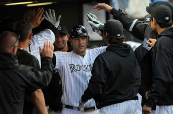 DENVER - APRIL 10:  Catcher Chris Iannetta #20 of the Colorado Rockies is welcomed back to the dugout after his third inning solo homerun against the San Diego Padres during MLB action at Coors Field on April 10, 2010 in Denver, Colorado.  (Photo by Doug