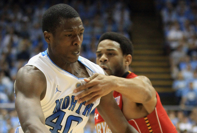 CHAPEL HILL, NC - FEBRUARY 27:  Sean Mosley #14 of the Maryland Terrapins fouls Harrison Barnes #40 of the North Carolina Tar Heels on his drive to the basket during their game at the Dean E. Smith Center on February 27, 2011 in Chapel Hill, North Carolin