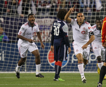 FOXBORO, MA - APRIL 10:  Dwayne DeRosario #14 of Toronto FC scores a goal against the New England Revolution at Gillette Stadium on April 10, 2010 in Foxboro, Massachusetts. (Photo by Jim Rogash/Getty Images)