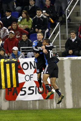 HARRISON, NJ - NOVEMBER 04: Bobby Convey #11 of the San Francisco Earthquakes is congratulated by his teammate Ryan Johnson #19 for his goal in the first half against the New York Red Bulls during the second leg of the of the MLS playoffs at Red Bull Aren