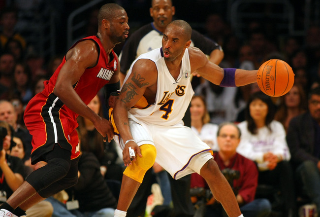LOS ANGELES, CA - DECEMBER 25:  Kobe Bryant #24 of the Los Angeles Lakers dribbles to the basket against Dwyane Wade #3 of the Miami Heat during the NBA game at Staples Center on December 25, 2010 in Los Angeles, California. NOTE TO USER: User expressly a