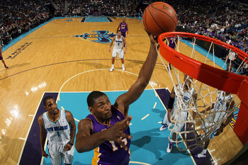 NEW ORLEANS, LA - DECEMBER 29: Ron Artest #15 of the Los Angeles Lakers shoots the ball over Trevor Ariza #1 of the New Orleans Hornets at the New Orleans Arena on December 29, 2010 in New Orleans, Louisiana.   The Lakers defeated the Hornets 103-88.  NOT
