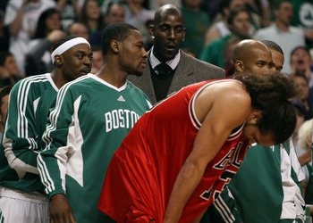 BOSTON - APRIL 20:  Kevin Garnett #5 of the Boston Celtics has a few words for Joakim Noah #13 of the Chicago Bulls in Game Two of the Eastern Conference Quarterfinals during the 2009 NBA Playoffs at TD Banknorth Garden on April 20, 2009 in Boston, Massac