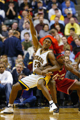 INDIANAPOLIS - DECEMBER 15:  Ron Artest #23 of the Indiana Pacers posts up LeBron James #23 of the Cleveland Cavaliers during the game at Conseco Fieldhouse on December 15, 2003 in Indianapolis, Indiana.  The Pacers won 95-85.  NOTE TO USER: User expressl
