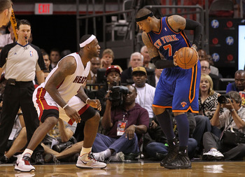 MIAMI, FL - FEBRUARY 27:  Carmelo Anthony #7 of the New York Knicks is guarded by LeBron James #6 of the Miami Heat during a game at American Airlines Arena on February 27, 2011 in Miami, Florida. NOTE TO USER: User expressly acknowledges and agrees that,