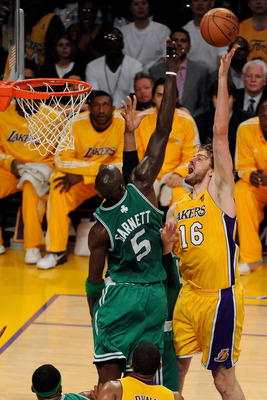 LOS ANGELES, CA - JUNE 17:  Pau Gasol #16 of the Los Angeles Lakers up for a shot over Kevin Garnett #5 of the Boston Celtics in Game Seven of the 2010 NBA Finals at Staples Center on June 17, 2010 in Los Angeles, California.  NOTE TO USER: User expressly