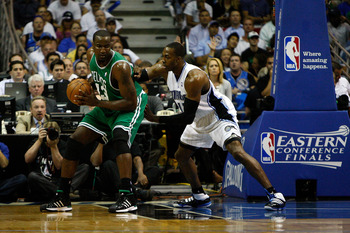 ORLANDO, FL - MAY 26:  Kendrick Perkins #43 of the Boston Celtics sets up in the post against Dwight Howard #12 of the Orlando Magic in Game Five of the Eastern Conference Finals during the 2010 NBA Playoffs at Amway Arena on May 26, 2010 in Orlando, Flor