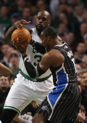 BOSTON, MA - JANUARY 17:  Shaquille O'Neal #36 of the Boston Celtics is called for a foul as Dwight Howard #12 of the Orlando Magic heads for the basket on January 17, 2011 at the TD Garden in Boston, Massachusetts.  NOTE TO USER: User expressly acknowled