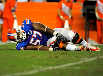GAINESVILLE, FL - SEPTEMBER 25:  Offensive lineman Carl Johnson #57 of the Florida Gators reaches for his injured ankle while taking on the Kentucky Wildcats at Ben Hill Griffin Stadium on September 25, 2010 in Gainesville, Florida.  (Photo by Doug Benc/G