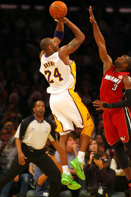LOS ANGELES, CA - DECEMBER 25:  Kobe Bryant #24 of the Los Angeles Lakers shoots the jump shot against Dwyane Wade #3 of the Miami Heat during the NBA game at Staples Center on December 25, 2010 in Los Angeles, California. The Heat defeated the Lakers 96-