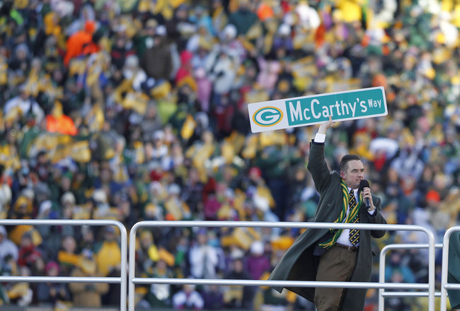 GREEN BAY, WI - FEBRUARY 08: Green Bay Mayor Jim Schmitt holds up a street sign for McCarthy's Way during the Packers victory ceremony at Lambeau Field on February 8, 2011 in Green Bay, Wisconsin.  (Photo by Matt Ludtke/Getty Images)