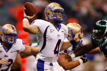 NEW ORLEANS - SEPTEMBER 04:  Quarterback G.J. Kinne #4 of the Tulsa Golden Hurricanes throws a pass against the Tulane Green Wave at the Louisiana Superdome on September 4, 2009 in New Orleans, Louisiana.   The Hurricanes defeated the Green Wave 37-13.  (