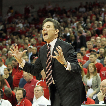 LOUISVILLE, KY - FEBRUARY 18:  Head coach Rick Pitino of the Louisville Cardinals gives instructions to his team during the Big East Conference game against the Connecticut Huskies at the KFC Yum! Center on February 18, 2011 in Louisville, Kentucky.  (Pho