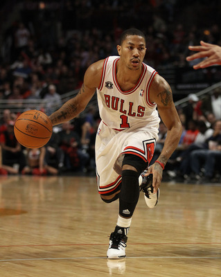 CHICAGO, IL - FEBRUARY 17: Derrick Rose #1 of the Chicago Bulls moves to the basket against the San Antonio Spurs at the United Center on February 17, 2011 in Chicago, Illinois. The Bulls defeated the Spurs 109-99. NOTE TO USER: User expressly acknowledge