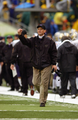 EUGENE, OR - NOVEMBER 16:  Head coach Rick Neuheisel of the Washington Huskies celebrates during the game against the Oregon Ducks on November 16, 2002 at Autzen Stadium in Eugene Oregon. The Huskies won 42-14. (Photo by Otto Greule Jr/Getty Images)