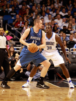 ORLANDO, FL - NOVEMBER 03:   Brandon Bass #30 of the Orlando Magic guards Kevin Love #42 of the Minnesota Timberwolves during the game at Amway Arena on November 3, 2010 in Orlando, Florida.  NOTE TO USER: User expressly acknowledges and agrees that, by d