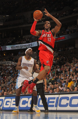 DENVER - DECEMBER 28:  LaMarcus Aldridge #12 of the Portland Trail Blazers takes a shot in front of Ty Lawson #3 of the Denver Nuggets at Pepsi Center on December 28, 2010 in Denver, Colorado. NOTE TO USER: User expressly acknowledges and agrees that, by