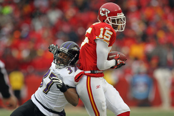 KANSAS CITY, MO - JANUARY 09:  Wide receiver Verran Tucker #15 of the Kansas City Chiefs makes a reception out of bounds as corner back Josh Wilson #37 of the Baltimore Ravens defends as the Ravens defeated the Chiefs 30-7 in their 2011 AFC wild card play