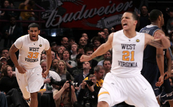NEW YORK - MARCH 13: Casey Mitchell #33 and Joe Mazzulla #21 of the West Virginia Mountaineers celebrate after a play against the Georgetown Hoyas during the championship of the 2010 NCAA Big East Tournament at Madison Square Garden on March 13, 2010 in N
