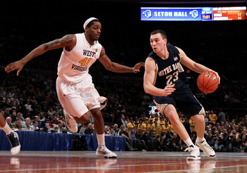 NEW YORK - MARCH 12: Ben Hansbrough #23 of the Notre Dame Fighting Irish handles the ball against John Flowers #41 of the West Virginia Mountaineers during the semifinal of the 2010 Big East Tournament at Madison Square Garden on March 12, 2010 in New Yor