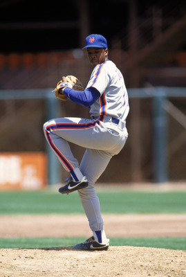 1990: Dwight Gooden of the New York Mets winds back to pitch during a game in the 1990 season. ( Photo by: Otto Greule Jr/Getty Images)