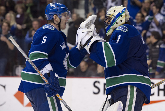 VANCOUVER, CANADA - FEBRUARY 4: Goalie Roberto Luongo #1 of the Vancouver Canucks celebrates with teammate Christian Ehrhoff #5 after defeating the Chicago Blackhawks in NHL action on February 04, 2011 at Rogers Arena in Vancouver, British Columbia, Canad