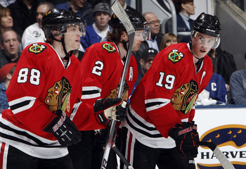 TORONTO, CANADA - MARCH 5: Patrick Kane #88, Duncan Keith #2 and Jonathan Toews #19 of the Chicago Blackhawks celebrate Jonathan Toews' goal during game action against the Toronto Maple Leafs at the Air Canada Centre March 5, 2011 in Toronto, Ontario, Can