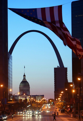 ST. LOUIS - APRIL 4:  A view of the Gateway Arch and the St. Louis Courthouse before dawn during the 2004 Spirit of St. Louis Marathon on April 4, 2004 in St. Louis, Missouri.  (Photo by Donald Miralle/Getty Images)