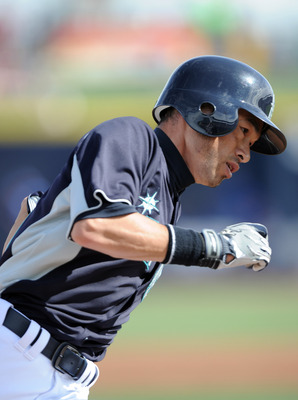 PEORIA, AZ - MARCH 01:  Ichiro Suzuki #51 of the Seattle Mariners runs home to score against the Texas Rangers during spring training at Peoria Stadium on March 1, 2011 in Peoria, Arizona.  (Photo by Harry How/Getty Images)