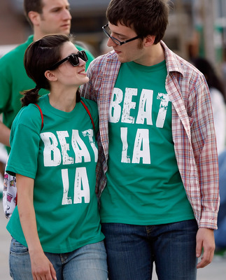 BOSTON - JUNE 17:  Boston Celtics fans walk down the street outside the TD Banknorth Garden before Game Six of the 2008 NBA Finals between the Los Angeles Lakers and the Celtics on June 17, 2008 at TD Banknorth Garden in Boston, Massachusetts. NOTE TO USE