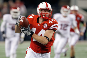 ARLINGTON, TX - DECEMBER 04:  Wide receiver Mike McNeil #44 of the Nebraska Cornhuskers pulls in a pass against the Oklahoma Sooners at Cowboys Stadium on December 4, 2010 in Arlington, Texas.  The Sooners beat the Cornhuskers 23-20.  (Photo by Tom Pennin