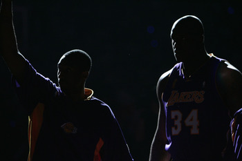 AUBURN HILLS, MI - JUNE 15:  Kobe Bryant #8 (left) and Shaquille O'Neal #34 of the Los Angeles Lakers are introduced against the Detroit Pistons before game five of the 2004 NBA Finals on June 15, 2004 at The Palace of Auburn Hills in Auburn Hills, Michig