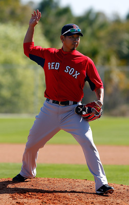 FORT MYERS, FL - FEBRUARY 19:  Pitcher Daisuke Matsuzaka #18 of the Boston Red Sox participates in a drill during a Spring Training Workout Session at the Red Sox Player Development Complex on February 19, 2011 in Fort Myers, Florida.  (Photo by J. Meric/