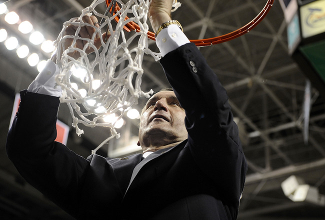 GREENSBORO, NC - MARCH 14: Mike Krzyzewski head coach of the Duke Blue Devils cuts down the net after win over the Georgia Tech Yellow Jackets in the championship game of the 2010 ACC Men's Basketball Tournament at the Greensboro Coliseum on March 14, 201