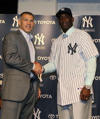 NEW YORK, NY - JANUARY 19:  Rafael Soriano (R) of the New York Yankees shakes hands with manager Joe Girardi during a press conference on January 19, 2011 at Yankee Stadium in the Bronx borough of New York City. The Yankees signed Soriano to a three year