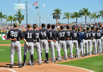CLEARWATER, FL - FEBRUARY 27:  Manager Joe Girardi #28 and players of the New York Yankees line up for pre-game introduction before play  against the Philadelphia Phillies February 27, 2011 at Bright House Field in Clearwater, Florida.  (Photo by Al Messe