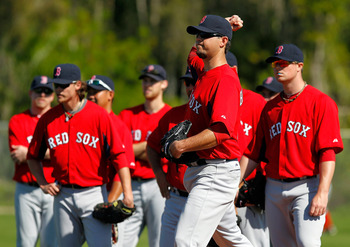 FORT MYERS, FL - FEBRUARY 19:  Pitcher Josh Beckett #19 of the Boston Red Sox participates in a drill during a Spring Training Workout Session at the Red Sox Player Development Complex on February 19, 2011 in Fort Myers, Florida.  (Photo by J. Meric/Getty