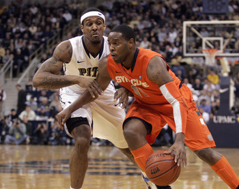PITTSBURGH, PA - JANUARY 17:  Scoop Jardine #11 of the Syracuse Orange drives to the basket as Gilbert Brown #5 of the Pittsburgh Panthers defends at Petersen Events Center on January 17, 2011 in Pittsburgh, Pennsylvania.  (Photo by Justin K. Aller/Getty