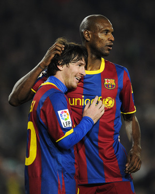 BARCELONA, SPAIN - FEBRUARY 05:  Lionel Messi of Barcelona (L) celebrates with his teammate Eric Abidal after scoring his third goal during the La Liga match between Barcelona and Atletico de Madrid at Camp Nou on February 5, 2011 in Barcelona, Spain. Bar