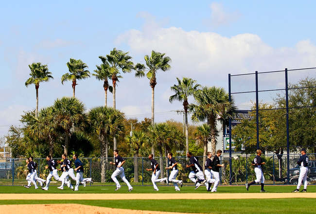 TAMPA, FL - FEBRUARY 21:  The New York Yankees run on the field during their second day of full teams workouts at Spring Training on February 21, 2011 at the George M. Steinbrenner Field in Tampa, Florida.  (Photo by Leon Halip/Getty Images)