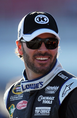 LAS VEGAS, NV - MARCH 04:  Jimmie Johnson, driver of the #48 Lowe's/Kobalt Tools Chevrolet, stands on the grid during qualifying for the NASCAR Sprint Cup Series Kobalt Tools 400 at Las Vegas Motor Speedway on March 4, 2011 in Las Vegas, Nevada.  (Photo b
