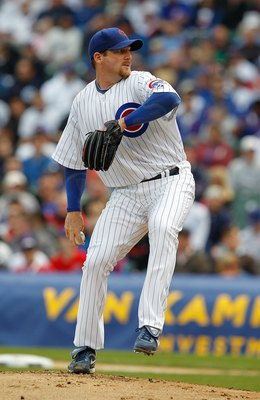 CHICAGO - APRIL 12: Starting pitcher Ryan Dempster #46 of the Chicago Cubs delivers the ball against the Milwaukee Brewers on Opening Day at Wrigley Field on April 12, 2010 in Chicago, Illinois. The Cubs defeated the Brewers 9-5. (Photo by Jonathan Daniel