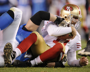 SAN DIEGO, CA - DECEMBER 16:  Quarterback Alex Smith #11 of the San Francisco 49ers is sacked by defensive end Luis Castillo #93 of the San Diego Chargers in the second quarter at Qualcomm Stadium on December 16, 2010 in San Diego, California.  (Photo by