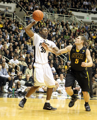 WEST LAFAYETTE, IN - JANUARY 09:  E'Twaun Moore #33 of the Purdue Boilermakers reaches for the ball against the Iowa Hawkeyes during the Big Ten Conference game at Mackey Arena on January 9, 2011 in West Lafayette, Indiana. Purdue won 75-52.  (Photo by An