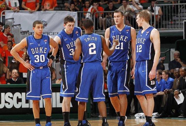 CORAL GABLES, FL - FEBRUARY 13: Nolan Smith #2 of the Duke Blue Devils talks to his teammates as they come back on court after a time out against the Miami Hurricanes on February 13, 2011 at the BankUnited Center in Coral Gables, Florida. The Blue Devils
